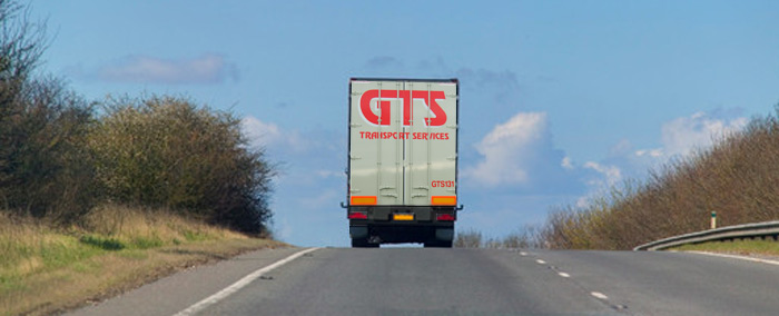 A GTS lorry driving through countryside
